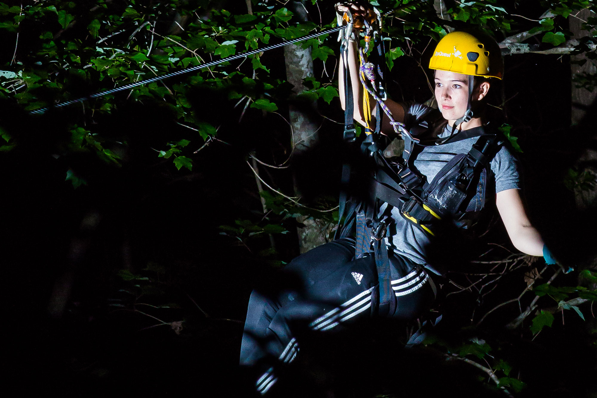Woman on Nightquest Nighttime Zipline adventure