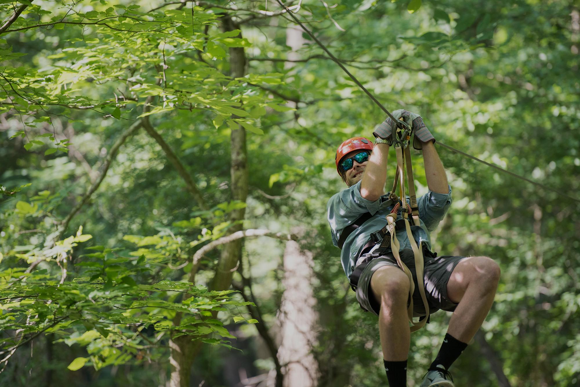Man Sliding Down Zipline in Fayetteville NC